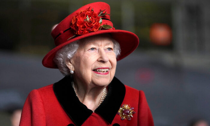 Queen Elizabeth II reacts during her visit to the aircraft carrier HMS Queen Elizabeth in Portsmouth, southern England on May 22, 2021. (Steve Parsons / Pool/AFP via Getty Images)