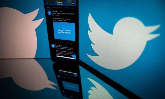 The logo of Twitter is displayed on the screen of a smartphone and a tablet in Toulouse, France, on Oct. 26, 2020. (Lionel Bonaventure/AFP via Getty Images)