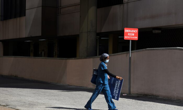 A health care worker leaves Houston Methodist Hospital in Houston, Texas, on May 4, 2020. (Callaghan O'Hare/Reuters)