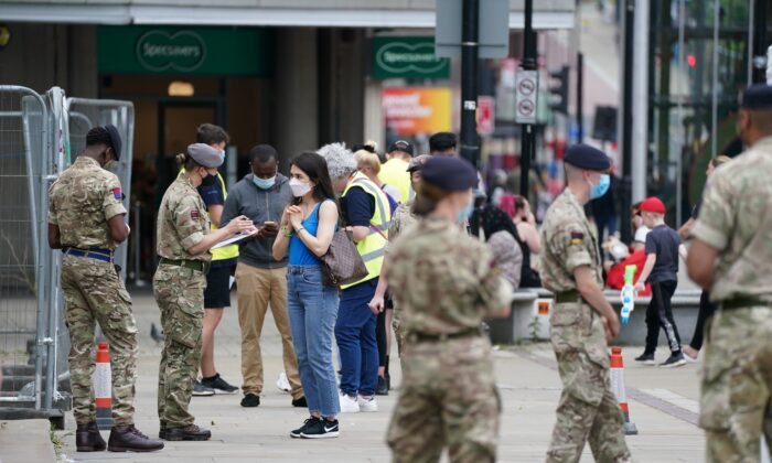 Members of the Armed Forces at a mobile COVID-19 vaccination centre outside Bolton Town Hall, Bolton, UK, on June 9, 2021. (Peter Byrne/PA Images)