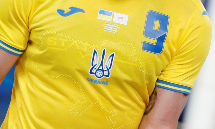 Ukraine's Roman Yaremchuk wears the newly unveiled national team jersey emblazoned with a map of Ukraine that includes Crimea during an international friendly match against Cyprus in Kharkiv, Ukraine, on June 7, 2021. (Gleb Garanich/Reuters)