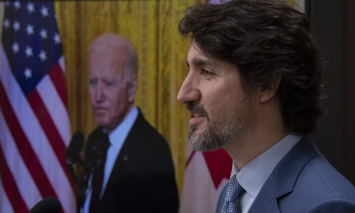 United States President Joe Biden listens as Canadian Prime Minister Justin Trudeau delivers his statement during a virtual joint statement following a virtual meeting in Ottawa, Feb. 23, 2021. (The Canadian Press/Adrian Wyld)