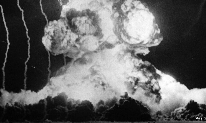 A Signal Corps camera records the burst of an atomic bomb during an atomic bomb test at Yucca Flat, Nev., on March 17, 1953.  (National Museum of the U.S. Navy via Wikimedia Commons)