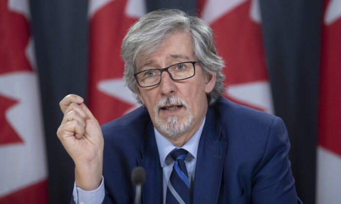 Privacy Commissioner Daniel Therrien speaks during a news conference in Ottawa, Dec. 10, 2019. The federal privacy czar says Canada's border agency violated the law by carrying out overly invasive searches of personal digital devices, in one case viewing a traveller's social media and online banking information. (The Canadian Press/Adrian Wyld)