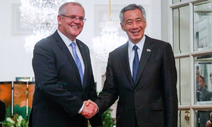 Australia's Prime Minister Scott Morrison (L) and Singapore's Prime Minister Lee Hsien Loong shake hands at the Istana Presidential Palace in Singapore on June 7, 2019. (Wallace Woon / Pool / AFP via Getty Images)