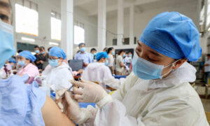Effectiveness of Chinese Vaccines Questioned as Sinovac Biotech Profits Soar