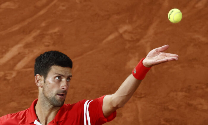 Serbia's Novak Djokovic in action during his quarter-final match against Italy's Matteo Berrettini at the 2021 French Open at Roland Garros in Paris, France, on June 9, 2021. (Christian Hartmann/Reuters)