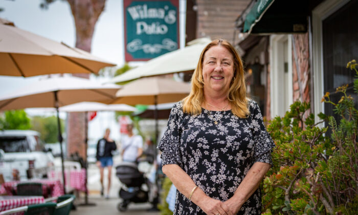 Owner Sheri Drewry stands in front of Wilma's Patio Restaurant in Newport Beach, Calif., on June 3, 2021. (John Fredricks/The Epoch Times)