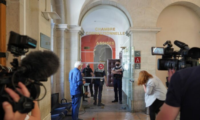 Reporters wait outside the courtroom as the 28-year-old man who slapped French President Emmanuel Macron is tried, facing possible jail time and a fine if found guilty of assaulting a public official, in Valence, central France, on June 10, 2021. (Laurent Cirpriani/AP Photo)