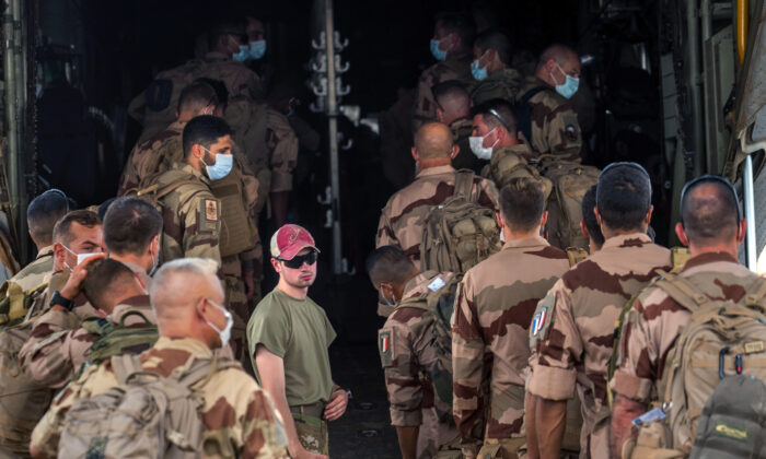 French Barkhane force soldiers who wrapped up a four-month tour of duty in the Sahel board a US Air Force C130 transport plane, leave their base in Gao, Mali, on June 9, 2021. (Jerome Delay/AP Photo)