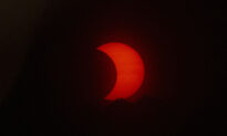 See the Spectacular Solar Eclipse Painting the Sky Red in New Jersey