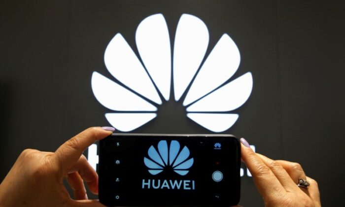 A Huawei logo is seen on a cell phone screen in their store at Vina del Mar, Chile, on July 18, 2019. (Rodrigo Garrido/Reuters)