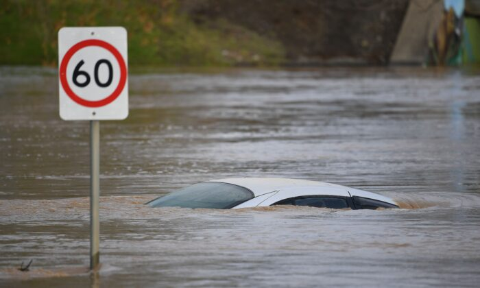 A car is seen submerged by flood water in Traralgon, Victoria, Australia on June 10, 2021. (AAP Image/James Ross)