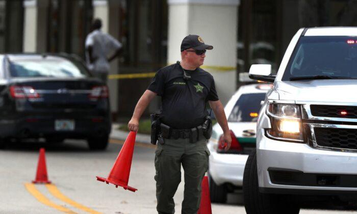 A Palm Beach County Sheriff deputy at the scene of a shooting inside a Publix along Okeechobee Blvd., in Royal Palm Beach, Fla., on June 10, 2021. (Carline Jean/South Florida Sun Sentinel/TNS)