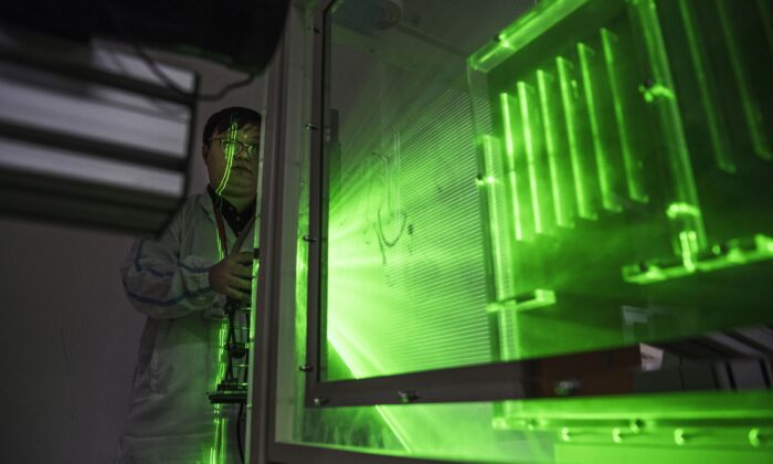 A Huawei thermal engineer performs a heat test in the research and development area of the Bantian campus in Shenzhen, China, on April 12, 2019. (Kevin Frayer/Getty Images)