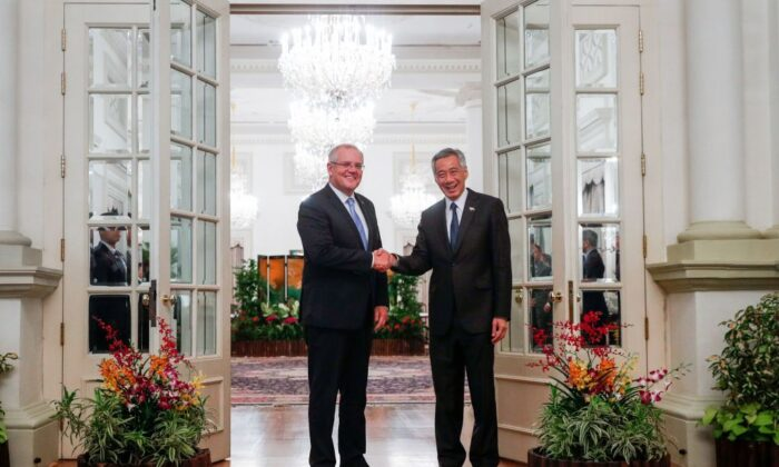 Australia's Prime Minister Scott Morrison (L) and Singapore Prime Minister Lee Hsien Loong shake hands at the Istana Presidential Palace in Singapore on June 7, 2019.        (Wallace Woon/AFP via Getty Images)