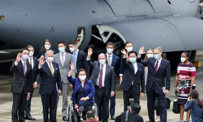 A delegation comprised of Senators Tammy Duckworth (3rd L), Christoper Coons (3rd R), and Dan Sullivan (2nd L), poses for photographs with Taiwan's Foreign Minister Joseph Wu (2nd R) and American Institute in Taiwan (AIT) Director Brent Christensen (R) following their arrival at the Songshan Airport in Taipei on June 6, 2021. (Pei Chen/POOL/AFP via Getty Images)