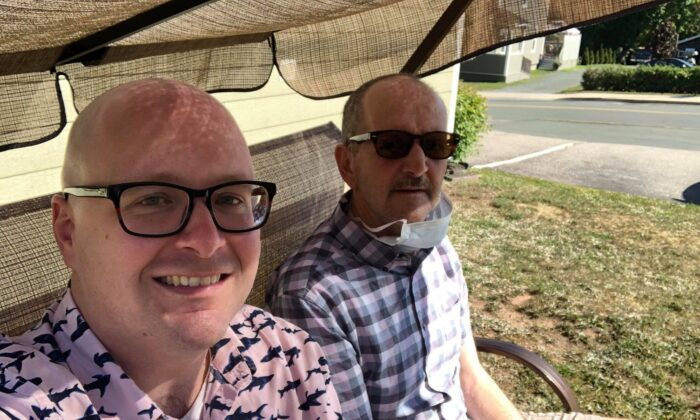 Steve Ellis (L) with his father, Roger Ellis, who suffers from a mysterious neurological syndrome that has appeared in clusters in New Brunswick, in Bathurst, N.B., in August 2020. (Courtesy of Steve Ellis)