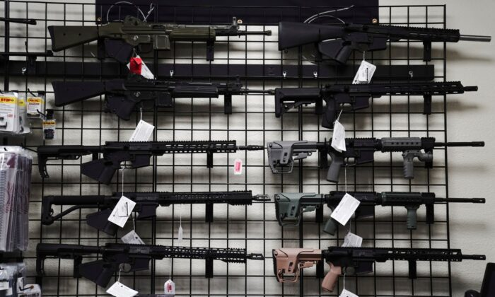 AR-15 style rifles are displayed for sale at Firearms Unknown, a gun store in Oceanside, Calif., on April 12, 2021. (Bing Guan/Reuters)