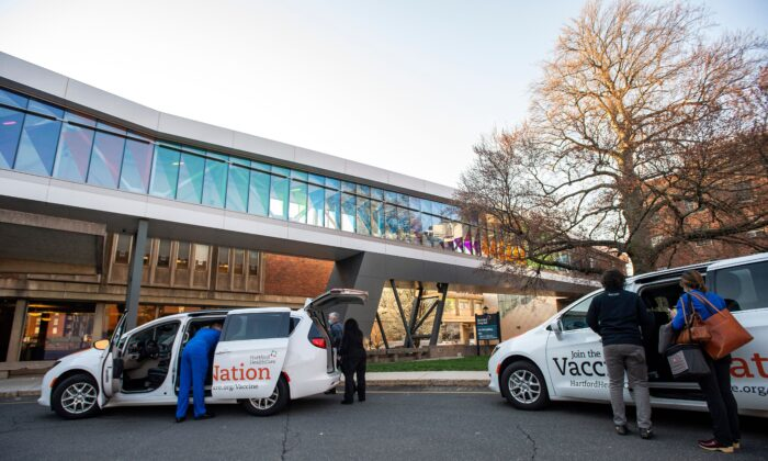 Hospital staffers are seen outside Hartford Hospital in Hartford, Conn., on April 20, 2021. (Joseph Prezioso/AFP via Getty Images)