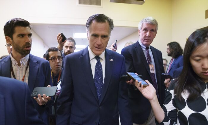 Sen. Mitt Romney (R-Utah) is surrounded by reporters as he walks to the Senate chamber at the Capitol in Washington on June 10, 2021. (J. Scott Applewhite/AP Photo)