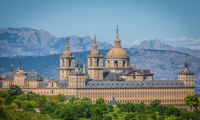 To secure and ensure the longevity of El Escorial, it was built like a fortress from gray granite quarried from the surrounding mountains. It is located 55 miles west of Madrid, in the heart of Spain. (Lukasz Janyst/Shutterstock)