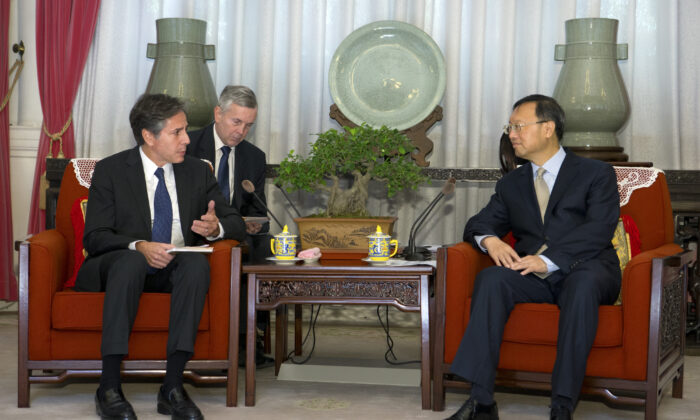 Then-U.S. Deputy Secretary of State Antony Blinken (L) speaks with Chinese State Councilor Yang Jiechi during a meeting in Beijing on Oct. 8, 2015. (Mark Schiefelbein, Pool/AP)