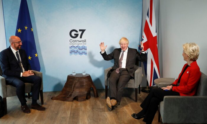 Britain's Prime Minister Boris Johnson (C) greets President of the European Council Charles Michel (L) and President of the European Commission Ursula von der Leyen prior to a bilateral meeting during the G7 summit in Carbis bay, Cornwall, on June 12, 2021. (Peter Nicholls/Pool/AFP via Getty Images)
