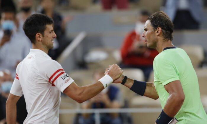 Serbia's Novak Djokovic shakes hands with Spain's Rafael Nadal after winning their semifinal match of the French Open tennis tournament at the Roland Garros stadium in Paris, France, on June 11, 2021. (Sarah Meyssonnier/Reuters)