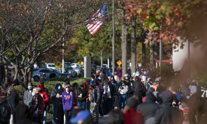 People wait in line to participate in early voting in Greenville, South Carolina, on Oct, 31, 2020. (Sean Rayford/Getty Images)