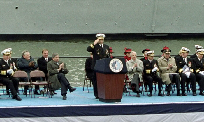U.S. Navy Commander Carlos Del Toro salutes the audience at the commissioning of the battleship USS Bulkeley in New York City on Dec. 8, 2001. (Getty Images)