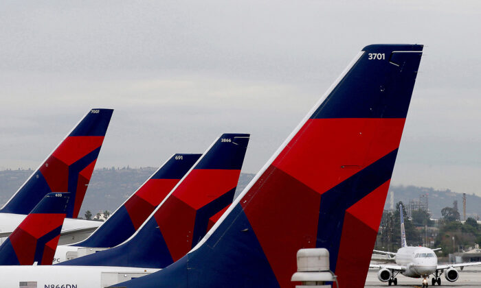 Delta Airlines aircraft are lined up at Terminal 5 in Los Angeles International Airport on Dec. 21, 2016. (Luis Sinco/Los Angeles Times/TNS)