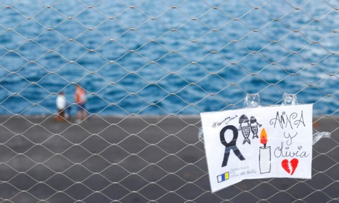 A sign placed on a fence in memory of the missing girls in the Canary Islands is seen in Santa Cruz de Tenerife, Spain, on June 11, 2021. (Borja Suarez/File/Reuters)