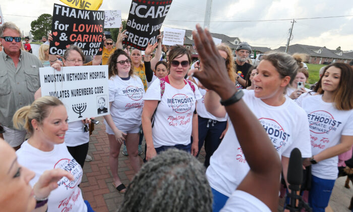 People gather to protest Houston Methodist Hospital system's rule of firing any employee who is not immunized by June 7, 2021, at Houston Methodist Baytown Hospital in Baytown, Texas. (Yi-Chin Lee/Houston Chronicle via AP)