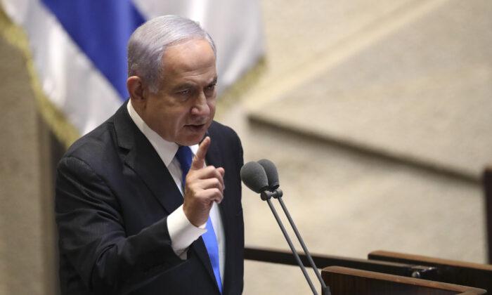 Israel's outgoing prime minister Benjamin Netanyahu speaks during a Knesset session in Jerusalem on June 13, 2021. (Ariel Schali/AP Photo)