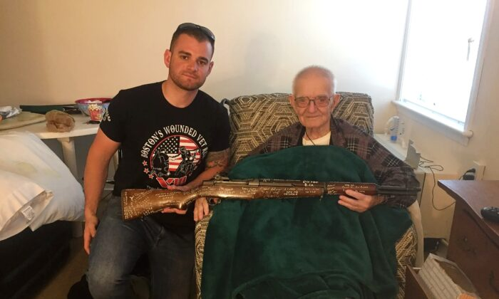 """Marine Corps Sgt. Andrew Biggio (L), the author of """"The Rifle: Combat Stories from America's Last WWII Veterans, Told Through an M1 Garand,"""" poses with a WWII veteran. (TheWWIIRifle.com)"""