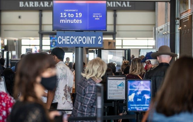 Travelers wait to go through security checkpoints at Austin-Bergstrom International Airport in Austin, Texas, on May 28, 2021. (Austin American-Statesman/TNS)