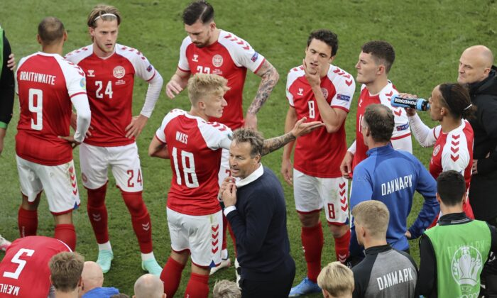 Denmark's manager Kasper Hjulmand instructs his players during the half time of the Euro 2020 soccer championship group B match between Denmark and Finland at Parken stadium in Copenhagen, Denmark, on June 12, 2021. (Wolfgang Rattay/Pool via AP)