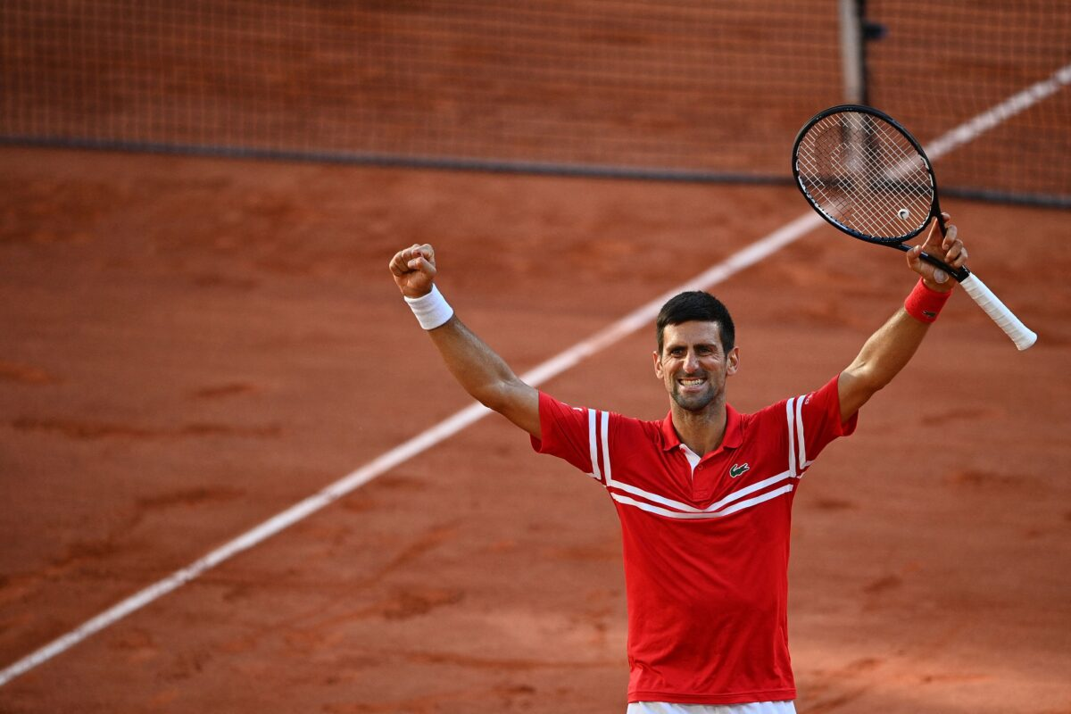 Djokovic celebrates after winning French Open