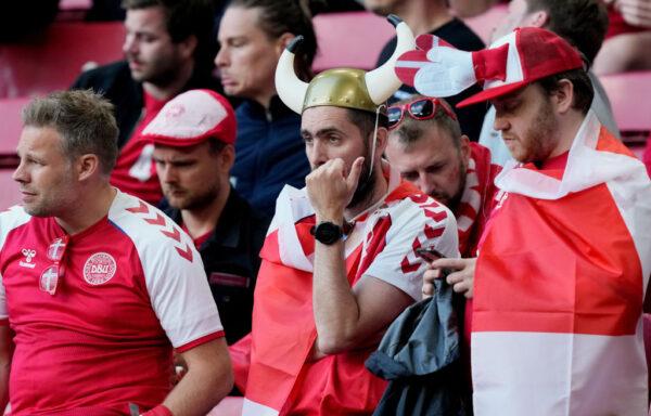 Fans of Denmark look dejected
