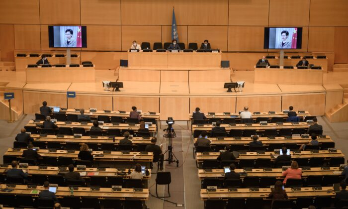 Hong Kong's chief executive Carrie Lam is seen on a giant screens remotely addressing the opening of the UN Human Rights Council's 44th session in Geneva, Switzerland, on June 30, 2020. (Fabrice Coffrini/AFP via Getty Images)