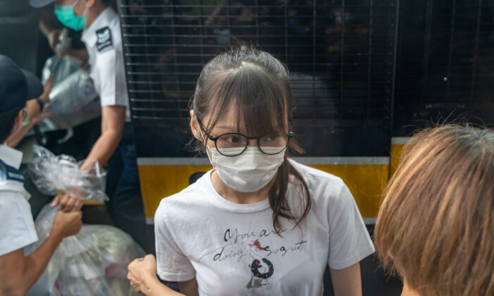 Hong Kong pro-democracy activist Agnes Chow steps out of a Hong Kong Correctional Services vehicle after being released from the Tai Lam Correctional Institution in Tuen Mun district in Hong Kong on June 12, 2021. (Anthony Kwan/Getty Images)