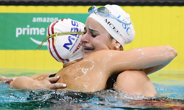 Kaylee McKeown (right) in tears hugs Minna Atherton after breaking the the world record in her Women's 100 Metre Backstroke final during the Australian National Olympic Swimming Trials at SA Aquatic & Leisure Centre in Adelaide, Australia, on June 13, 2021. (Mark Brake/Getty Images)
