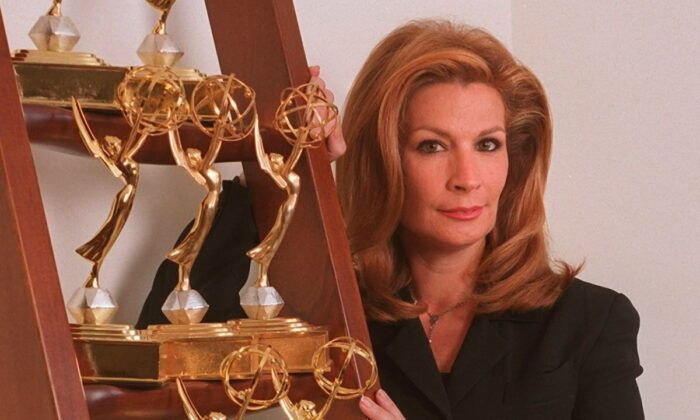Michele Gillen, an investigative reporter for WFOR-CBS 4, poses at her home with her Emmy Awards, on Nov. 27, 2000. (Marice Cohn Band/Miami Herald via AP)