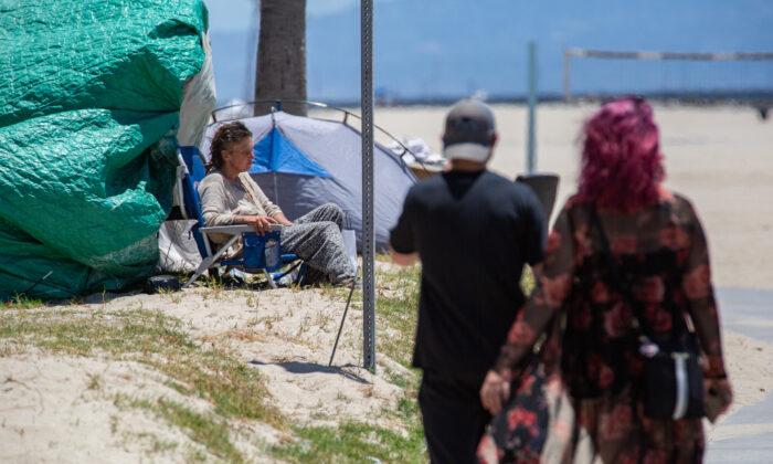 A homeless individual in Venice Beach, Calif., on June 8, 2021. (John Fredricks/The Epoch Times)