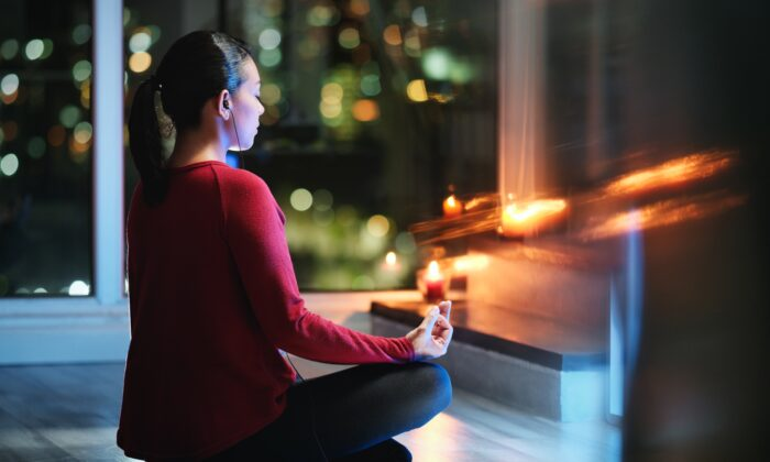 Meditating before bed can calm your mind and make it easier to get a restful sleep. (Diego Cervo/Shutterstock)