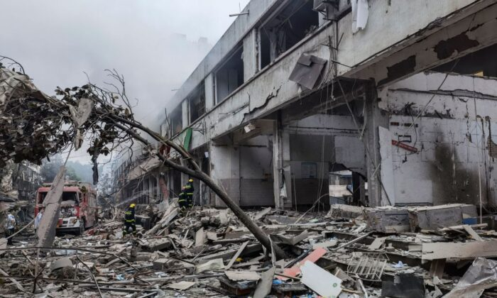 Workers search for victims in a building damaged by a gas line explosion which left at least 12 people dead and nearly 140 others injured in Shiyan, in central China's Hubei province, on June 13, 2021. (CNS/AFP via Getty Images)