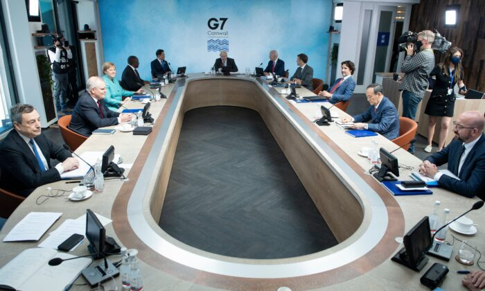 A general view of G7 leaders and their guests is pictured at a working sesssion during the G7 summit in Carbis Bay, Cornwall, UK, on June 12, 2021. (Brendan Smialowski/POOL/AFP via Getty Images)