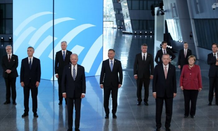 NATO Heads of the states and governments pose for a family photo during the NATO summit at the Alliance's headquarters, in Brussels on June 14. (Yves Herman/Pool/Reuters)