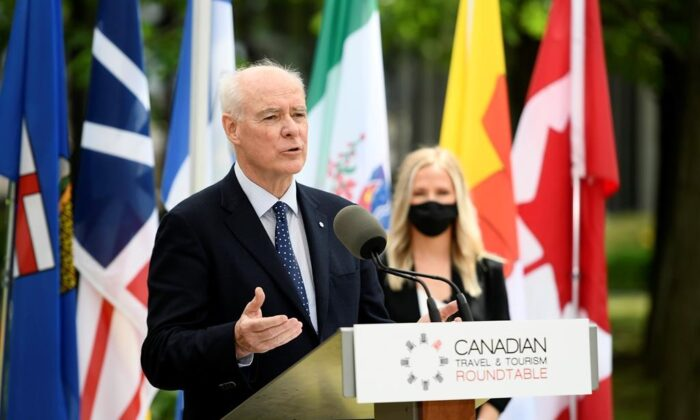 Perrin Beatty, President and CEO of the Canadian Chamber of Commerce, speaks during a news conference held by the Canadian Travel and Tourism Roundtable, a coalition of airports, airlines, hotels, boards of trade and chambers of commerce, to urge the federal government to implement a reopening plan for travel and tourism, at the Ottawa Airport in Ottawa, on June 14, 2021. (The Canadian Press/Justin Tang)